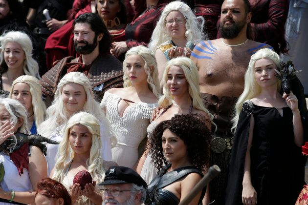 A group of cosplayers dressed as Game of Thrones character Daenerys Targaryen, pose for photos with otherss...