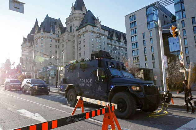 A Royal Canadian Mounted Police vehicle passes the Fairmont Chateau Laurier as it leaves a secure area downtown following shootings in Ottawa Oct. 22, 2014.