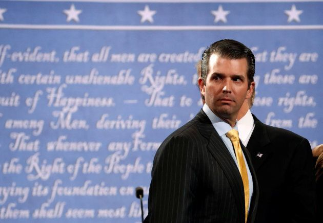 Donald Trump Jr. stands onstage with his father Republican U.S. presidential nominee Donald Trump after...