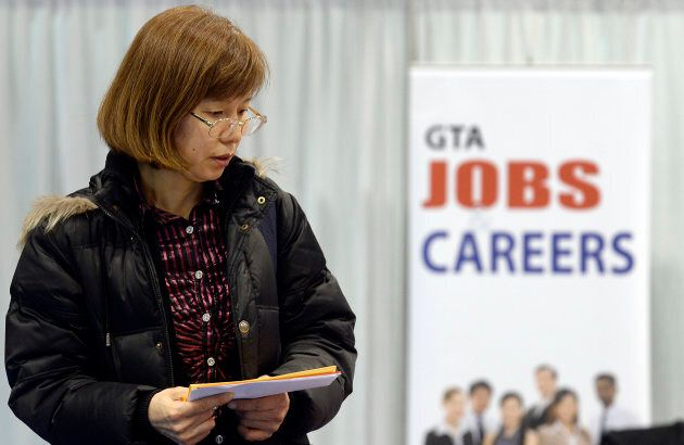A woman walks through the 2014 Spring National Job Fair and Training Expo in Toronto, Ont. April 3,