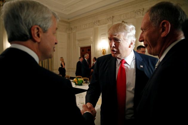 U.S. President Donald Trump shakes hands with JPMorgan Chase & Co CEO Jamie Dimon (left) as he hosts...