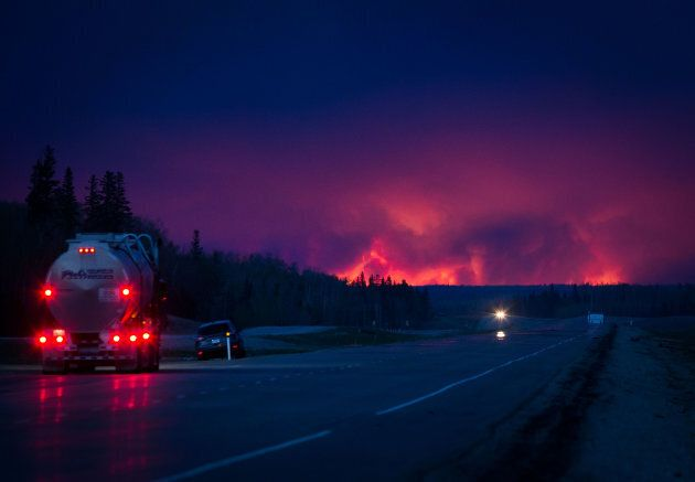 A truck drives on a highway as a wildfire burns south of Fort McMurray, Alberta, Canada, on Wednesday,...