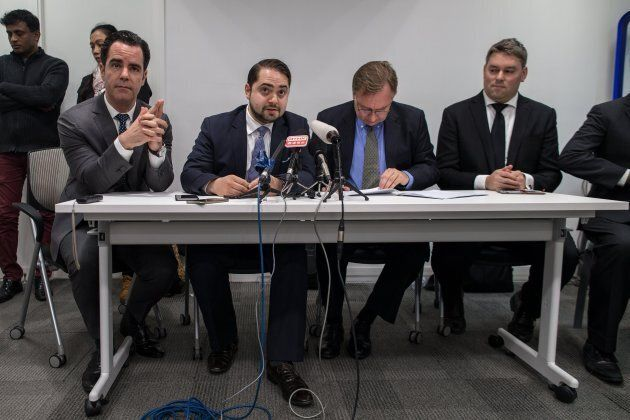 Lawyers for three asylum seekers families Robert Tibbo, (2-R), and his Montreal based Canadian counterparts...