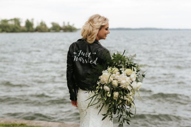 Brit Littleford posing in the jacket on her wedding day.