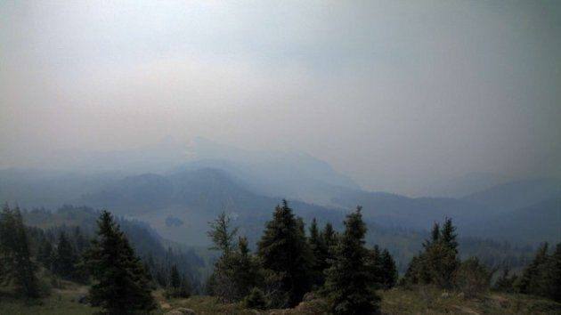 A wildfire has filled the sky with smoke in Banff, Alta. This image was taken Monday on Sunshine Village's Rock Isle Lake webcam.