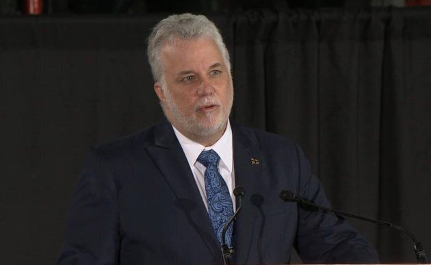 Philippe Couillard delivers a speech during a funeral ceremony held for six people at Maurice Richard...