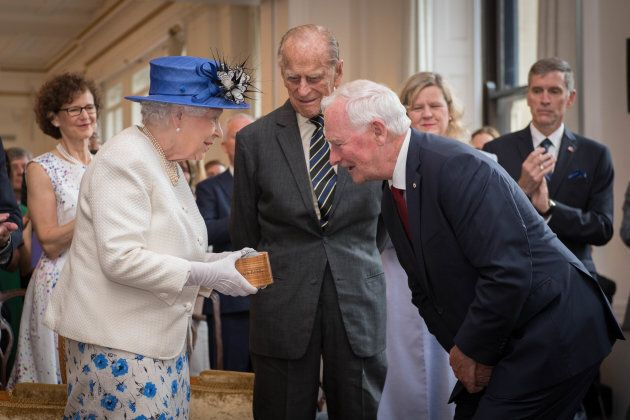 Queen Elizabeth II and Prince Philip are welcomed to Canada House by Gov. Gen. David Johnston for her...