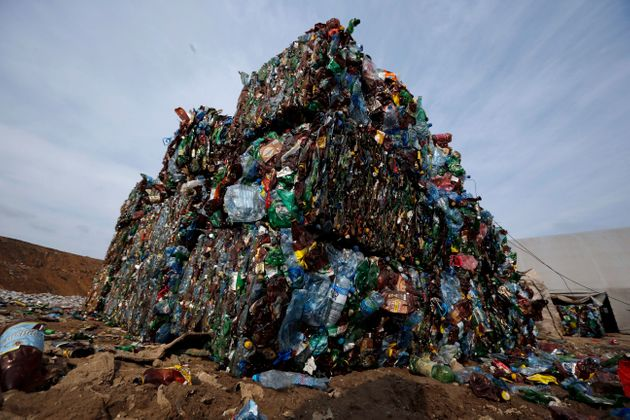 In this March 12, 2015 file photo, plastic trash is compacted into bales ready for further processing...
