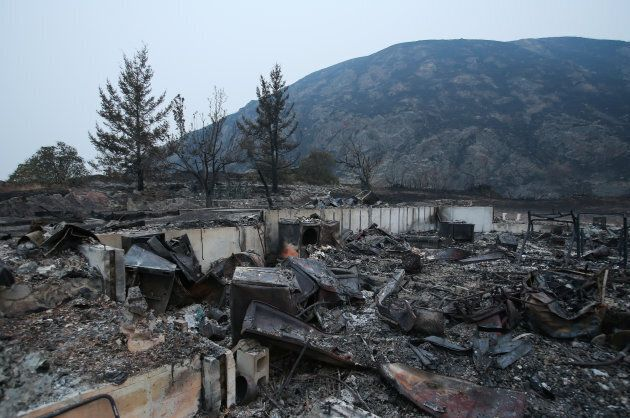 The remains of a home after being destroyed by a wildfire in Boston Flats, British Columbia, Canada July...