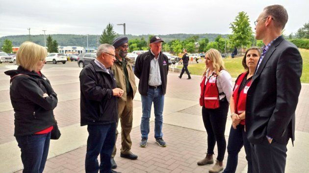Public Safety Minister Ralph Goodale, second from left, and Defence Minister Harjit Sajjan, to the right of him, met with provincial officials in Kamloops.