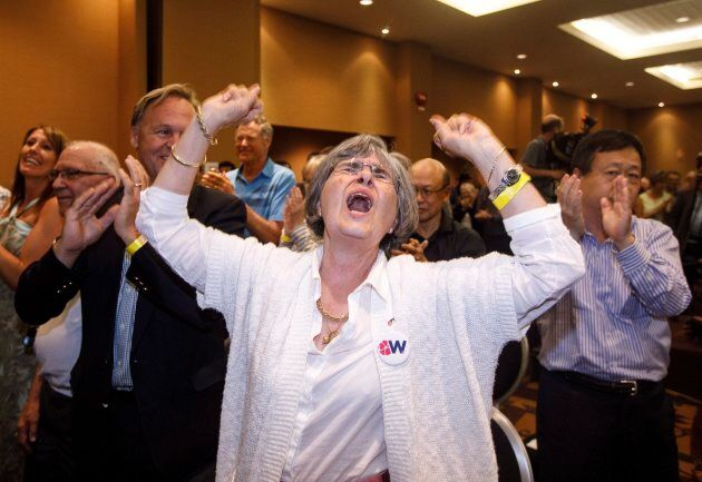 Wildrose supporters celebrate the yes vote in Red Deer Alta, on July 22,