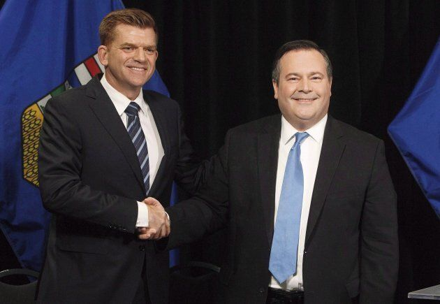 Alberta Wildrose leader Brian Jean, left, and Alberta PC leader Jason Kenney, right, shake hands after...