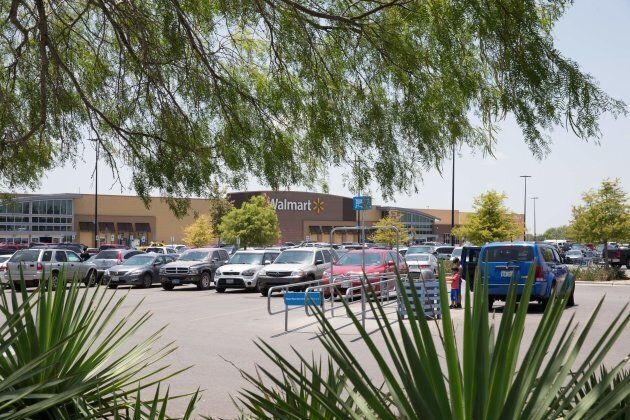 The parking lot of a Walmart, where a truck trailer was found with deceased immigrants early in the morning,...
