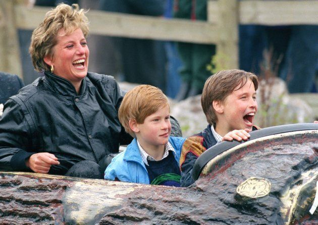 Diana, Princess Of Wales, with Princes William and Harry at an amusement