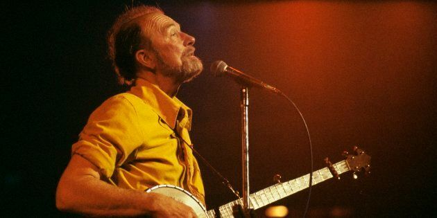 Pete Seeger performing on stage.