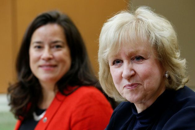Former prime minister Kim Campbell waits with Justice Minister Jody Wilson-Raybould to testify before the House of Commons justice committee in Ottawa on Oct. 24, 2016.