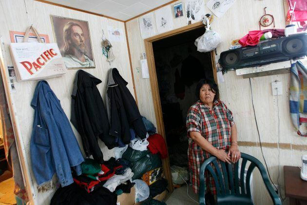 Pikangikum First Nation resident Juliette Turtle stands in her living room as she talks about her seven...