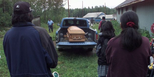 Family and friends watch as Cynthia Jane Keeper is taken to her resting place after a funeral service...