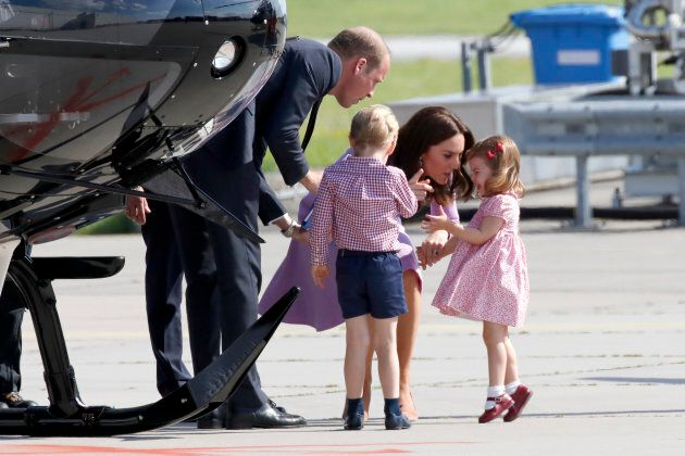 The Duke and Duchess of Cambridge try to calm their daughter who is throwing a tantrum. (Photo by Franziska...