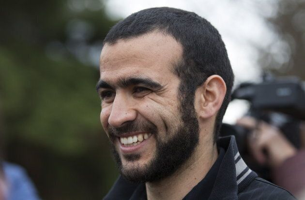 Omar Khadr smiles as he answers questions during a news conference after being released on bail in Edmonton...