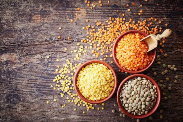 Bowls of various legumes (red turkish lentils, yellow indian lentils, canadian