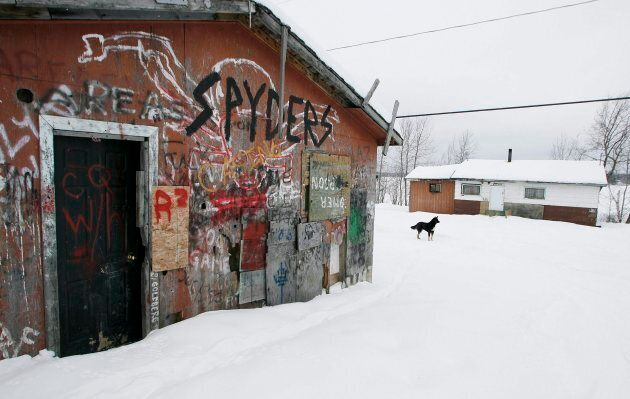 An abandoned house is shown on the Pikangikum First Nation in