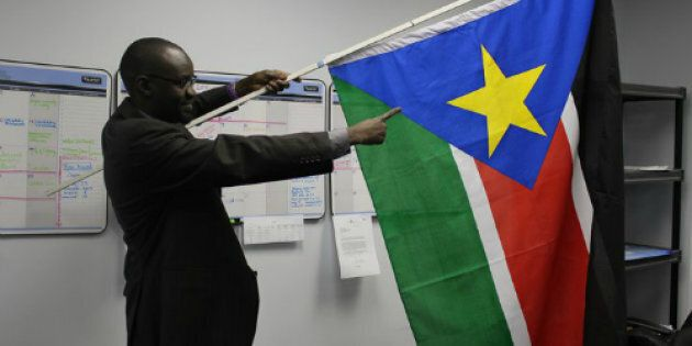 Philip Gai holds a South Sudanese flag in January, 2011 after the referendum vote to become a separate state from Sudan.