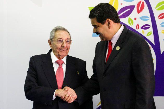 Venezuela's President Nicolas Maduro (R) welcomes Cuban President Raul Castro to the 17th Non-Aligned...