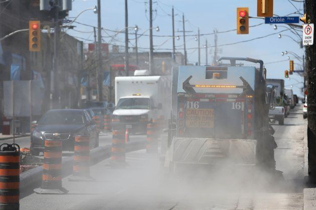 Dust flies as Eglinton businesses west of Yonge Street are being impacted by the crosstown LRT construction  in Toronto, Ont. on April 15, 2015.