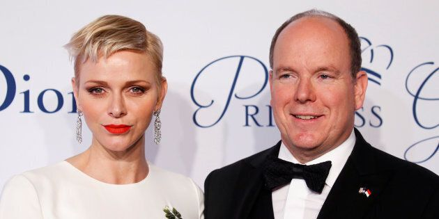 Prince Albert II of Monaco arrives with his wife Princess Charlene of Monaco for the 2016 Princess Grace...