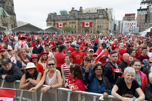 Crowds cheer during during Canada Day celebrations on Parliament Hill during a three-day official visit by The Prince Of Wales & Duchess Of Cornwall to Canada on July 1, 2017 in Ottawa, Ont.