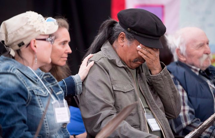 Dennis Shorty wipes away tears after speaking about residential schools at the National Inquiry into Missing and Murdered Indigenous Women and Girls taking place in Whitehorse, Yukon, Tuesday, May 30, 2017.