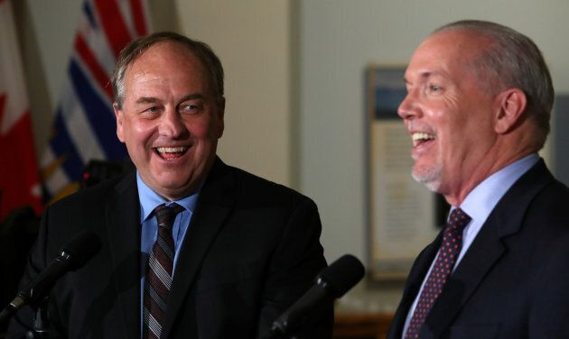 British Columbia Green leader Andrew Weaver and New Democrat leader John Horgan answer questions in the British Columbia legislature building in Victoria on May 30, 2017.