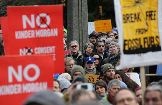 Protesters hold a rally at City Hall before a march against the proposed expansion of Kinder Morgan's Trans Mountain Pipeline in Vancouver on Nov. 19, 2016.