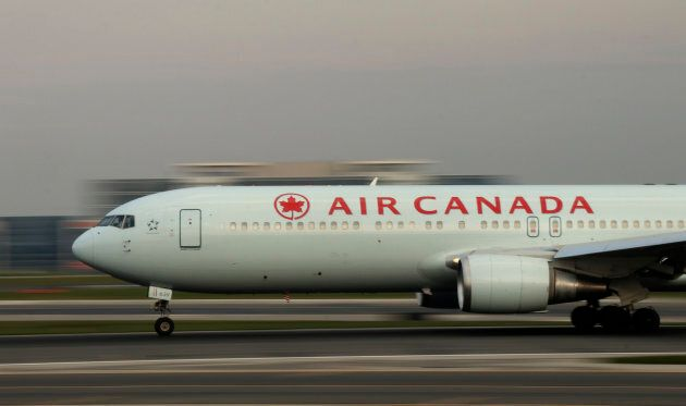 An Air Canada airplane takes off at Toronto Pearson International Airport. (Photo by Gary Hershorn/Getty