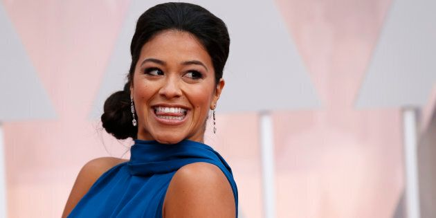 Actress Gina Rodriguez, wearing a bright blue Manon Gabard gown, arrives at the 87th Academy Awards in...