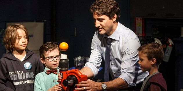 Prime Minster Justin Trudeau performs a science experiment with kids while visiting with families at...