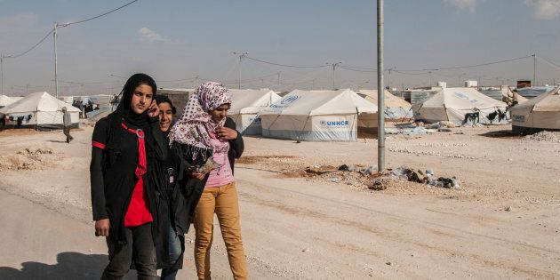 Syrian refugees are seen at the Zaatari  refugee camp, on the Jordanian border on 31 May 2017.