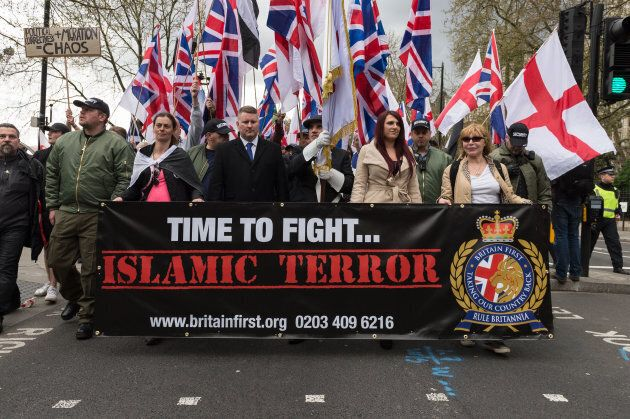 Leaders of Britain First, Jayda Fransen (2R) and Paul Golding (3L) lead March Against Terrorism on April 01, 2017 in London, England. Supporters of far-right political movement Britain First gathered in central London to protest against Islam and Islamic terrorism in the wake of the recent Westminster terror attack.