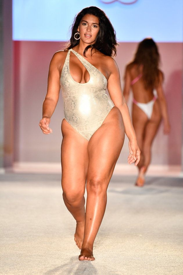A model walks the runway during SWIMMIAMI Sports Illustrated Swimsuit 2018 Collection in Miami Beach,