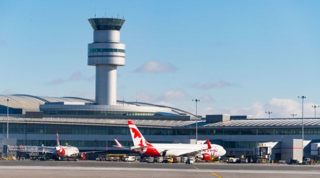 Air Canada Rouge tourist plane and control tower at Toronto's Pearson International