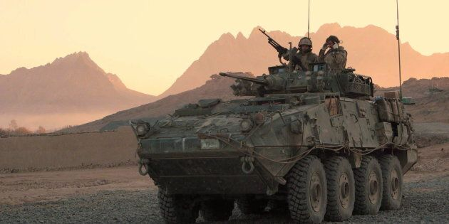 A Canadian LAV (light armoured vehicle) arrives to escort a convoy at a forward operating base near Panjwaii,...