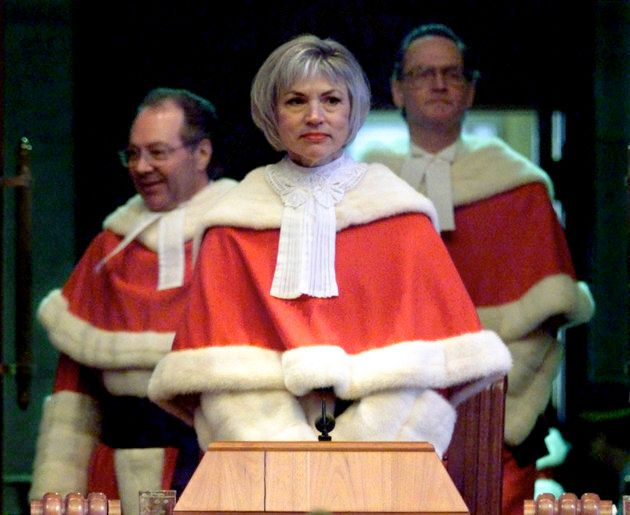Chief Justice Beverley McLachlin is flanked by Justices Michel Bastarache (L) and Ian Binnie (R) upon...