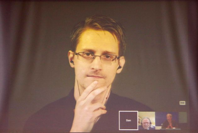 Former U.S. National Security Agency contractor Edward Snowden appears live via video during a meeting...