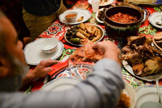 The Egyptian-American Muslim Elhariry family takes part in Iftar dinner during Ramadan in Manalapan,...