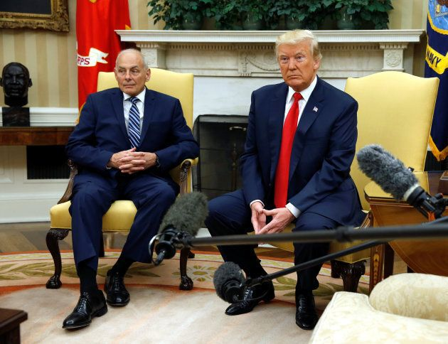 U.S. President Donald Trump sits after John Kelly was sworn in as White House Chief of Staff in the Oval...