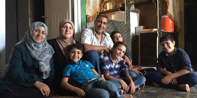 Omaima (far left) and her family at home in Za'atari refugee camp, Jordan. Step by step they have made their container like a home.