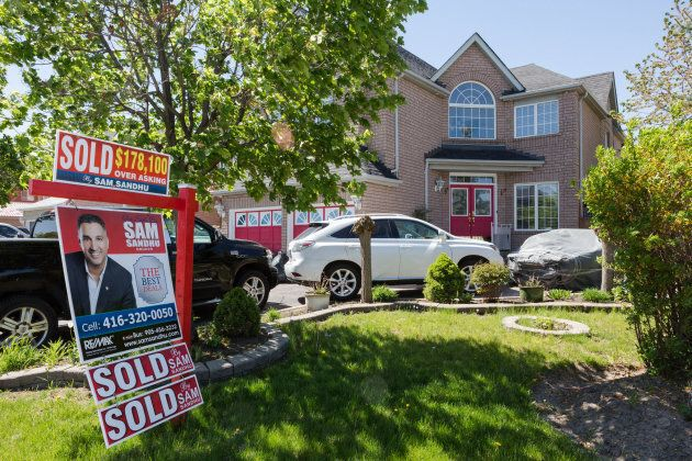 A 'Sold $178,100 Over Asking' sign is displayed outside of a house in Brampton, Ont., on Saturday, May...