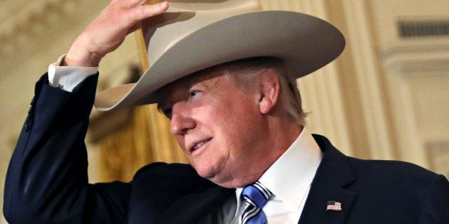 U.S. President Donald Trump wears a cowboy hat as attends