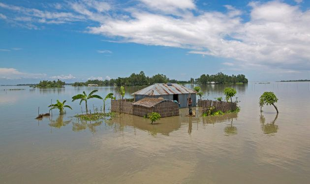 A sinking house is seen during a flood in Lalmonirhat, Bangladesh on July 15, 2017. Bangladesh is one...